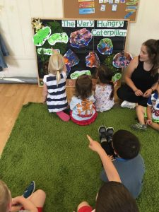 Kids listening to the Very Hungry Caterpillar story